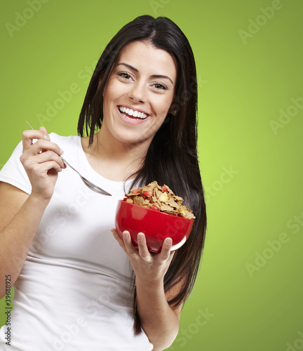 woman holding a bowl with cereals