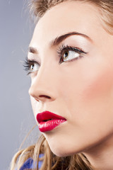 Portrait of young beautiful blond girl with stylish make-up