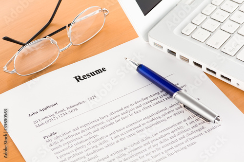 Resume with Pen by Laptop