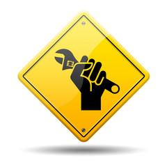 Señal amarilla simbolo reparacion