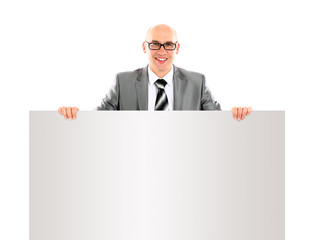 smiling young business man showing blank signboard