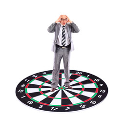 Businessman  placed on a dartboard