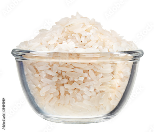Polished long rice heap in small glass bowl, isolated on white