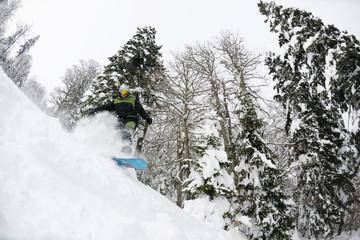 snowboarder on fresh deep snow