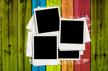 Blank Photos on Multicolored Wood Plank Background