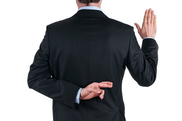 young businessman in suit telling a lie with the fingers crossed