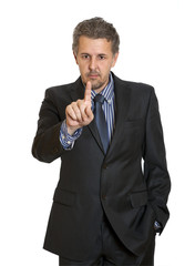 Portrait of an angry middle aged businessman in suit
