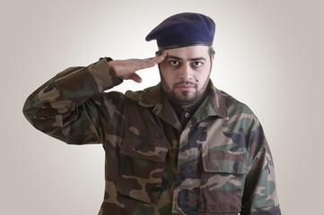 A soldier salutes - clipping path included