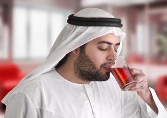 arabian guy drinking tea / aroma tempting beverage scene