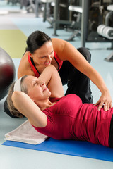 Senior woman exercise abdominal in fitness center