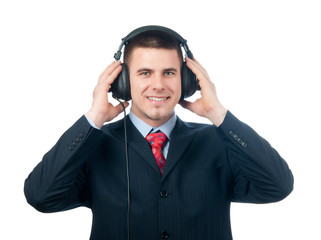 Smiling handsome businessman listening to music