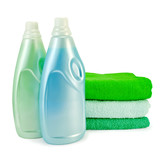 Fabric softener in two bottles and towels