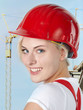 Young girl with red helmet wants to build a house