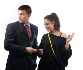 Worried young businessman giving money to the lady