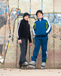 Teenage boys on roller skates posing outdoor