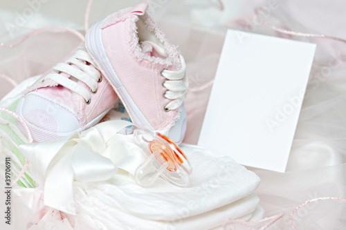 Baby shoes and pacifier on diapers. Photo Frame