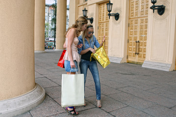 Two girls with vibrant shoping bags