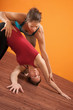 Yoga Trainer Assisting Student