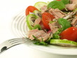 Tuna salad with tomatoes on isolated background