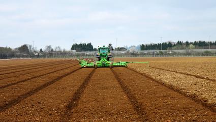 Tractor & Plow Tilling a Field