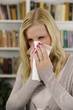 Woman with flu or allergy sneezing