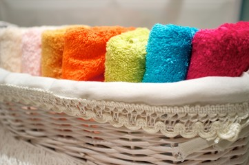 Colorful towels in basket.