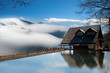 Dramatic clouds with mountain and small house
