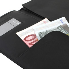 Black leather wallet with money and credit cards