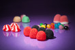 Candy assortment on purple background