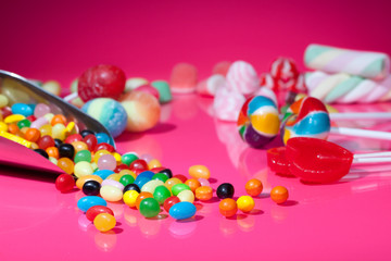 Candy assortment on pink background