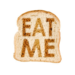 """Toast of bread """"eat me"""", white background"""