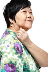 senior woman holding her aching back