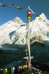 view of everest from gokyo ri with prayer flags