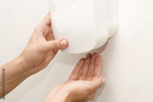 Wall Mounted Sanitizer Dispenser with Woman Hand