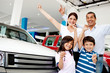Happy family with new car