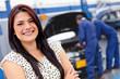 Woman at a car garage