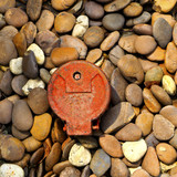 Natural pebble stones with old water meter.
