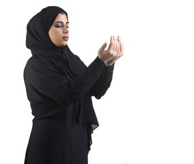 islamic woman wearing hijab & praying
