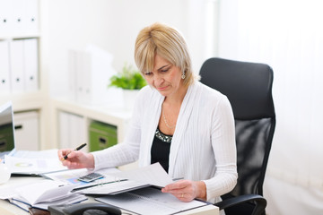 Mature business woman working at office