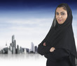 professional islamic woman wearing hijab against a cityscape