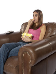 Movie night watching TV eating popcorn