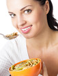Woman eating muesli or cornflakes, isolated