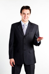 portrait of a young manager for motor with a small red toy car