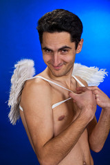 Glamour man with white wings.