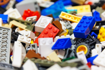Heap of color plastic toy bricks