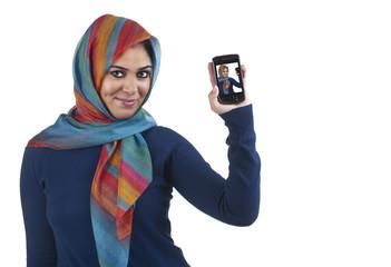 beautiful stylish islamic girl wearing hijab with mobile phone
