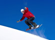 Snowboarder jumping through air with deep blue sky
