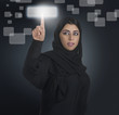 arabian businesswoman pressing a touchscreen button with hijab