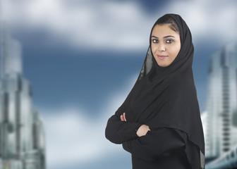 professional islamic executive wearing hijab against cityscape
