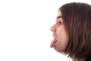 Profile of man face sticking out tongue